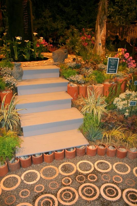clay pipes in landscape with steps and plants
