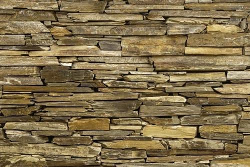 flagstones make a garden wall and edge