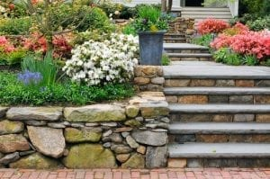 rocks are stacked to create a garden wall and steps