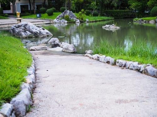 natural rocks line a path and create a garden edge