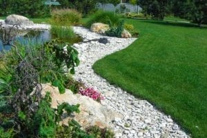 dry stream bed is built as a garden edge