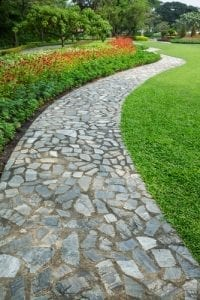 cobblestones make a path and a lawn edge