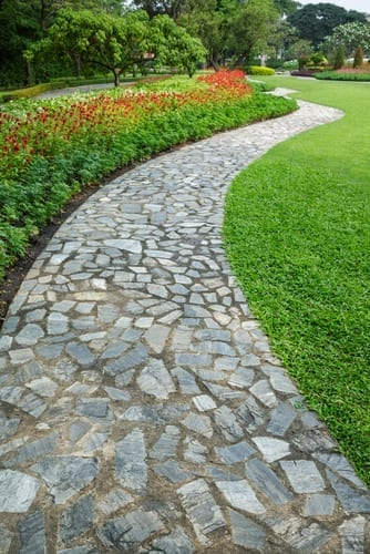 cobblestones make a path and a lawn edge