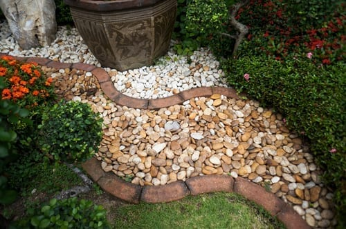 garden pathway made with contrasting rock and brick