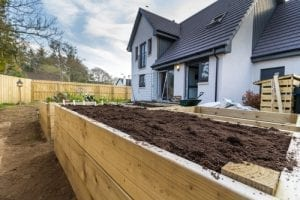 raised garden bed that was just built filled with dirt
