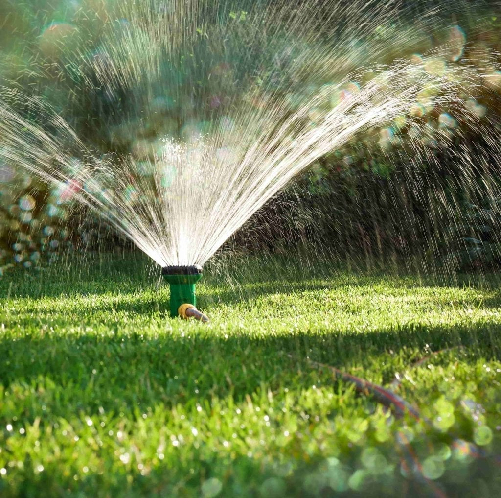 prep your garden for cold weather sprinkler in yard watering lawn and garden