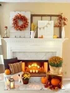 Seasonal fall mantel decor using pumpkins and mums
