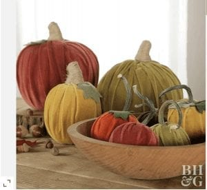 Pumpkins made from velvet on a table for fall decor