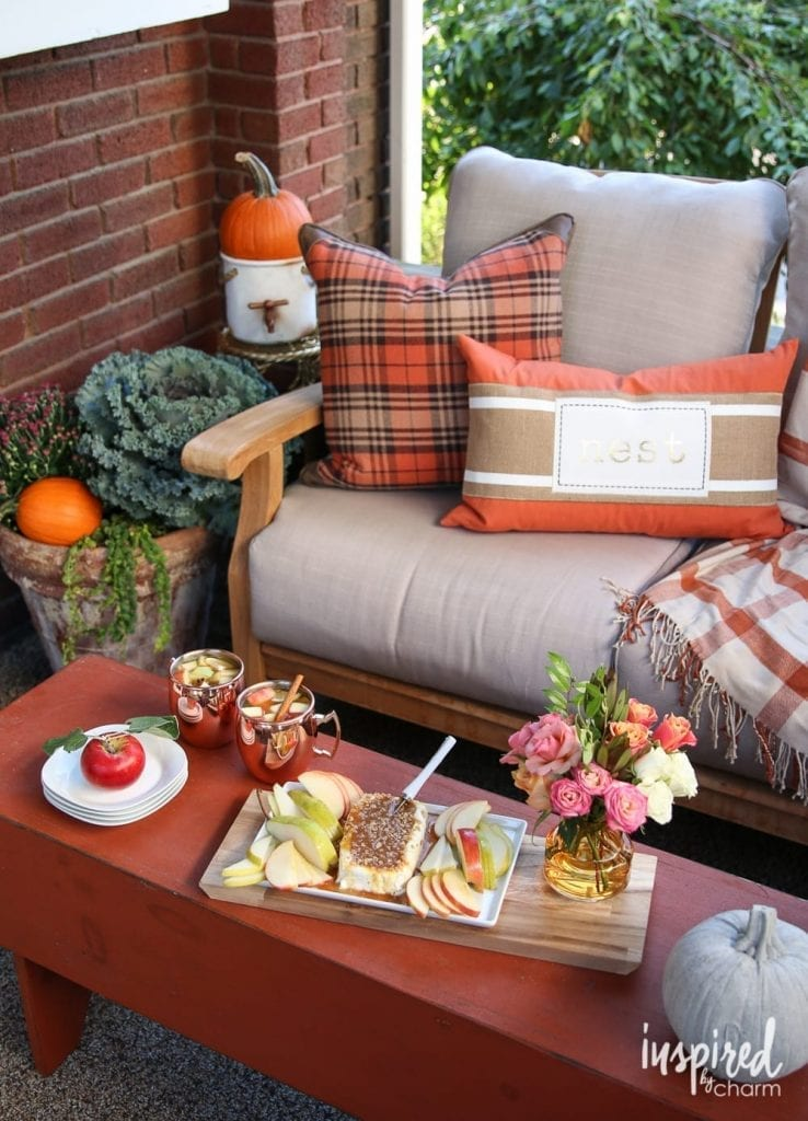 patio with fall decor copper mugs and orange accents