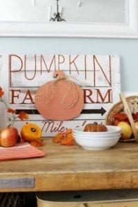 fall decor Pumpkin patch sign is sitting on a table with apples and pumpkins