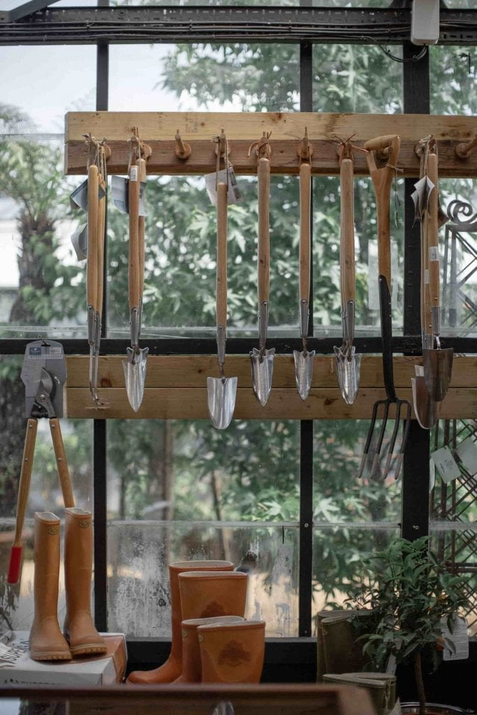 Gardening Tools Hanging from a Rack in a Toolshed
