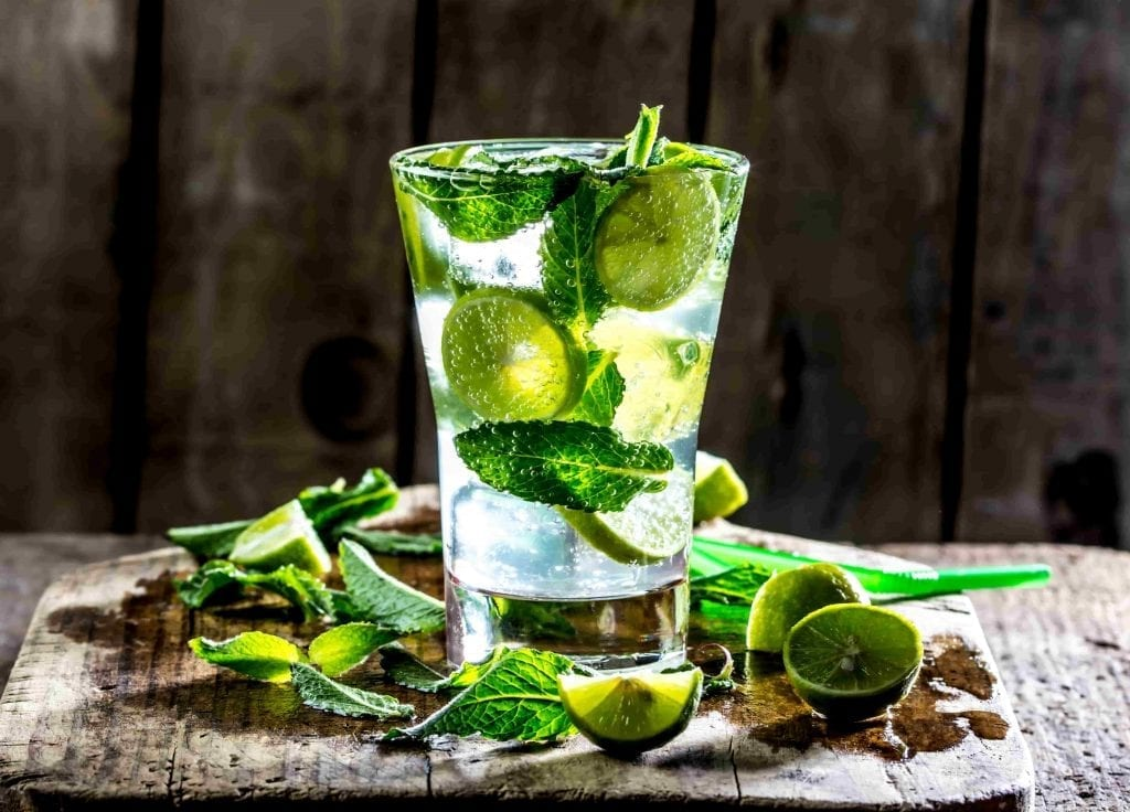 glass of mojito cocktail with mint and lime