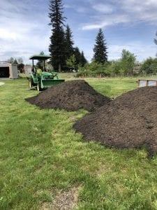 John Deere tractor with garden soil