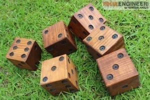 large brown dice with black spots for playing in yard