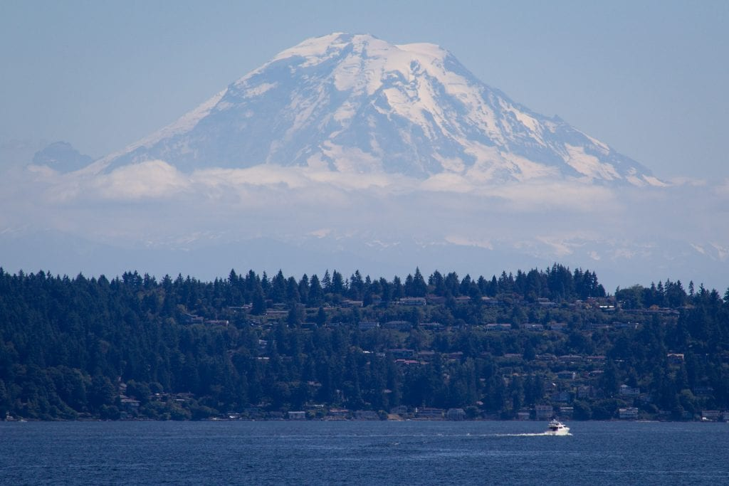 Mt. Rainier volcano seen in distance over Lake Washington